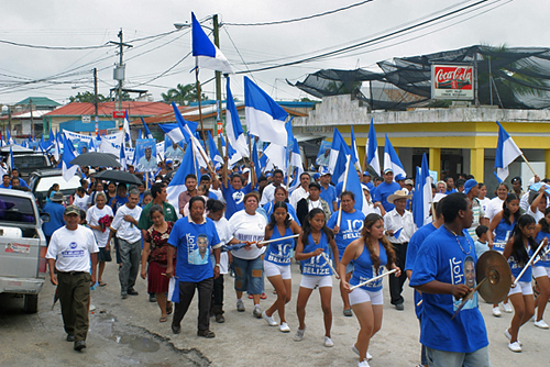 People United Party (PUP) candidates and supporters march.
