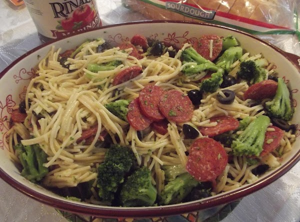 In a casserole dish, add pasta with broccoli mixture, the rest of the olive...