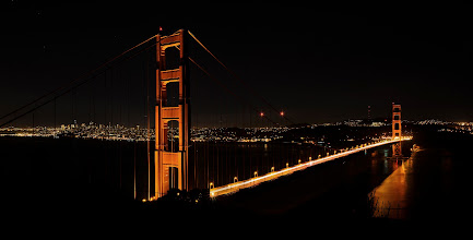 Photo: Golden Panoramic San Francisco, CA. 2012.  +Michael Bonocorewas raving about the panoramic images he's been making, and on our way from Baker Beach we were diverted to the road that goes by the Golden Gate Bridge overlook, we quickly decided to wait for a parking spot and get a panoramic of the bridge as a way to wrap up that evenings shoot.  We waited patiently for the throngs of tourists that were posing in front of the bridge, using flash and cellphones to capture their moment, and after about half an hour finally got our chance to make this image.  This is a four frame pano, stitched together in photoshop, and then adjusted in Lightroom (very minor adjustments), some detail was then extracted in OnOne pefect effects. (35mm f2 @ f8, ISO 200, 13 sec) -- These shots may be addictive, the 35mm f2 is one of my favorite lenses (right behind the 80-200 f2.8), its a sharper lens than the 10-24mm, i'm probably going to start using it more to make landscape panos.  The final image turned out to be about 50 megapixels, and i've uploaded it to Gigapan's site so you can check it out.  http://gigapan.com/gigapans/120635