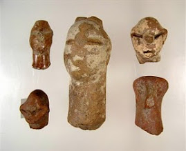 """Photo: The heads of Neolithic figurines dating back more than 7,000 years are seen in this undated handout photo provided by the Greek Culture Ministry on Tuesday, Oct. 30, 2007. The artifacts are part of a stolen collection of 94 Neolithic works returned from Greece to Germany, that were presented Tuesday by Culture Minister Michalis Liapis. Archaeologists said the """"expressive"""" figurines may have been modelled on real people.  (AP Photo/ Greek Culture Ministry/HO)"""