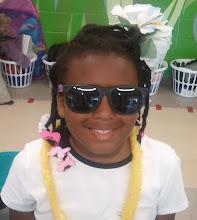 Photo: Kaleya & the school luau w/ her flower & lei