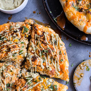 Buffalo Roasted Cauliflower Skillet Pizza with Chipotle Blue Cheese Avocado Drizzle.