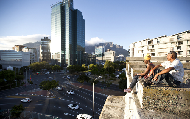 Cape Town residents Dorothy Pieterson and Hilton Esau watch the sunrise from a bridge in Cape Town's central business district in this February 14 2014 file photo.  Picture: THE TIMES