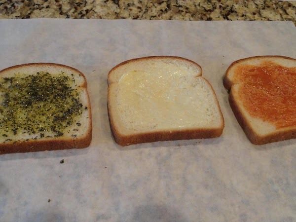 Assemble sandwich. On both sides of one slice bread, spread 2 teaspoons butter (1...