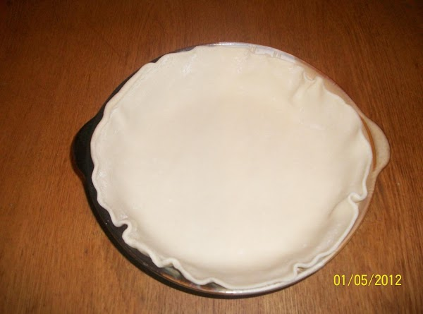 Line a 9-in. pie plate with bottom pastry; trim even with edge. In a...