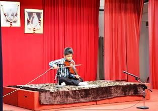 Photo: A young violin talent, Atmananda playing his violin