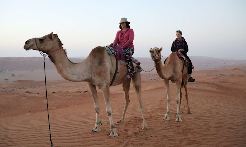 Camel riding with Mom in Oman | Krys Kolumbus Travel