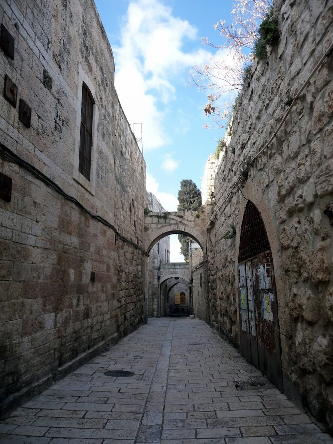 Travel to Israel - Jerusalem. Walking through the Armenian Quarter, one of the four neighborhoods comprising the Old City. You can't see most of it, just this one street alongside its walls
