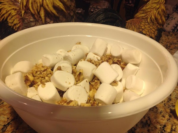 Add chopped walnuts to marshmallows and mix in with hands.