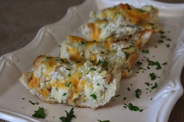 Garlicky, Cheesy French Bread W/ Artichoke Hearts Recipe