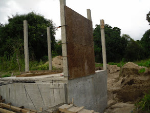 Photo: Once columns with rebar and concrete were erected, walls made out of plastic PET Bottles were installed.