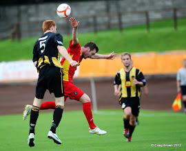 Photo: Berwick Rangers Football Club v Dunfermline Athletic Football Club - Pre Season Friendly Andy Kirk is pushed in the backAt Shielfield Park, Berwick24/07/2012Craig Brown | StockPix.eu