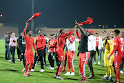 Highlands Park players celebrates winning during the MTN 8 semi final 2nd leg match between Highlands Park and Polokwane City at Makhulong Stadium on September 17, 2019 in Johannesburg, South Africa.