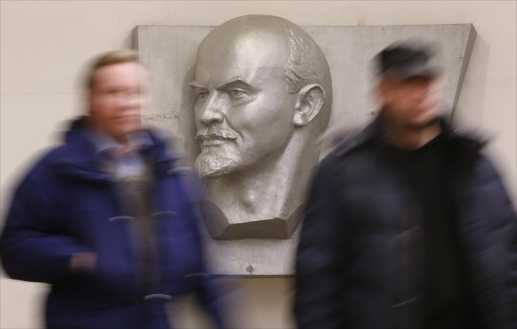 People walk in front of a representation of Soviet state founder Vladimir Lenin at Ploschad Ilyicha metro station in Moscow, Russia. Picture: REUTERS/SERGEI KARPUKHIN
