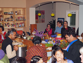 Photo: arranging snacks in two different places for the large crowd .jpg