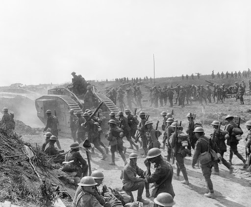 Mark V tanks with British and New Zealand infantry moving forward after the capture of Grevillers, 28 August 1918.
