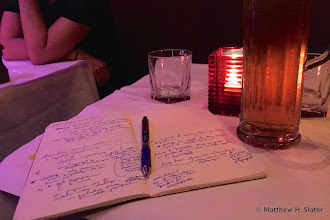 Photo: Doing a little paper planning between sets. . . .