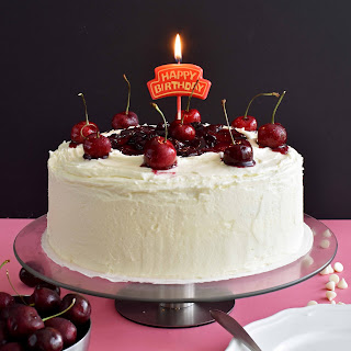 White Chocolate Cake with Cherry Sauce