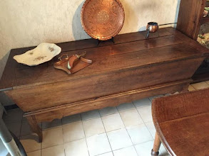 Photo: Code 3942. Long oak dough bin with Louis XV shaped legs and Provincial rail. circa 1870. SOLD
