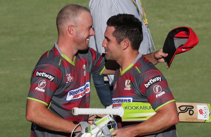 Dean Elgar (R) is congratulated by teammate AB de Villiers (L) after helping the Tshwane Spartans to victory during the Mzansi Super League match against the Jozi Stars at SuperSport Park in Centurion outside Pretoria on November 28 2018.