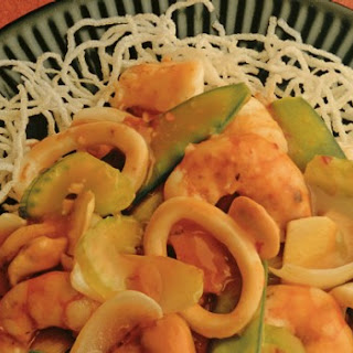 Sizzling Seafood On Crisp Rice Noodles.