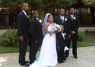 Photo: Tanesha with the groomsmen - Daddy was the best man, Izjan was the ringbearer.