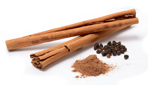Ceylon cinnamon from Sri Lanka: sticks, powder, and flowers.