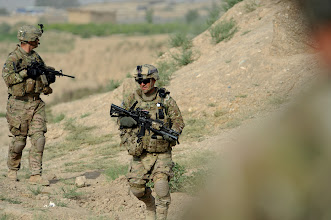 Photo: U.S. Army Staff Sgt. Edward Winkowski (front), squad leader, and 1st Lt. Michael Lopez (rear), platoon leader, patrol to the Tarnek River in Qalat City, Afghanistan, July 9, 2011. Both are members of Provincial Reconstruction Team Zabul's security force. PRT Zabul is comprised of Air Force, Army, Department of State, U.S. Agency for International Development of Agriculture and U.S. Army Corps of Engineer personnel who work with the government of Afghanistan to improve governance, stability, and development throughout the province. (U.S. Air Force photo/Senior Airman Grovert Fuentes-Contreras)(Released)