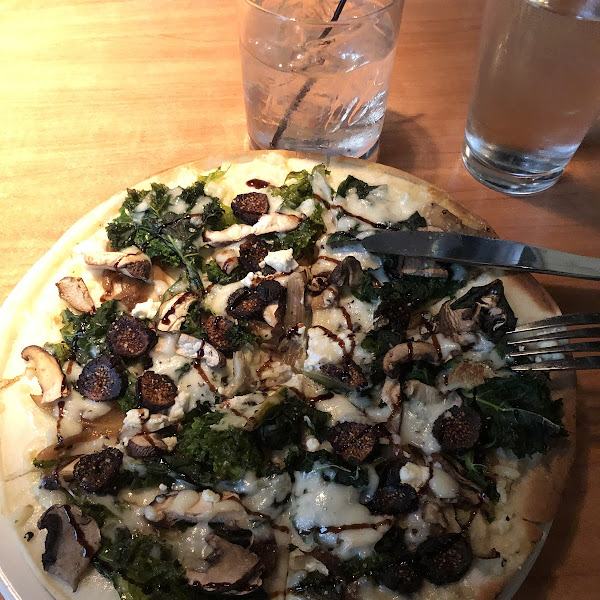 The Woodlands Pizza with figs, carmelized onions, mushrooms, and kale.