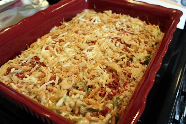 Adding cheese on top of casserole.
