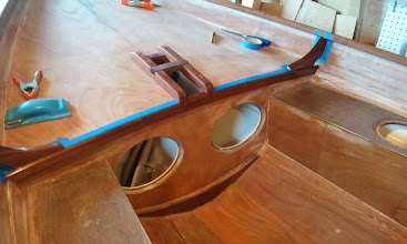 Photo: First coat of clear epoxy on the forward knees and bulkhead trim.