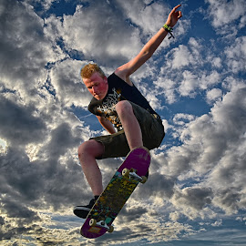Flying Board by Marco Bertamé - Sports & Fitness Skateboarding ( clouds, flying, balance, blue, cloudy, grey, dow, skating, stunt, skateboard, jump,  )