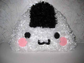 Photo: Large Onigiri Plushie Pillow Donated by: Nancy Matsudaira on behalf of Seattle RTG Taiko Groups  Giveaway date: Wednesday, December 18th
