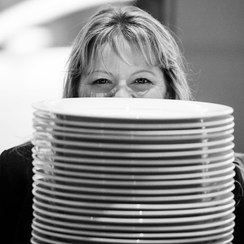 The VP of Procurement and Logistics hiding behind a stack of plates