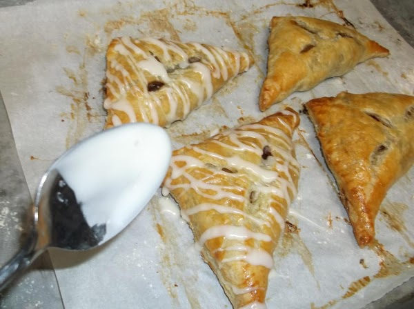 Slowly drizzle icing over turnovers. Serve.