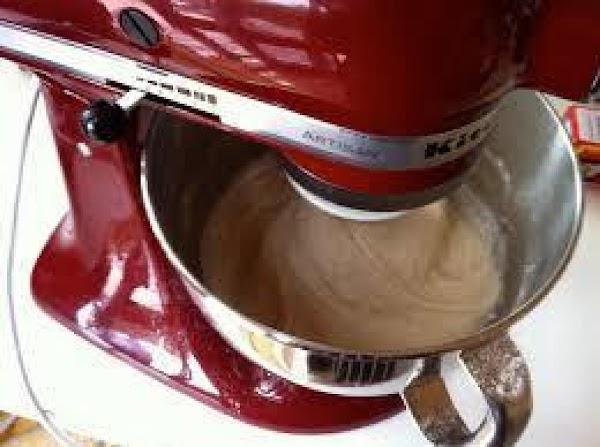 Add very soft butter and beaten egg. Mix well. With dough hook, gradually start...