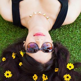 Spring bloom. by Eliani Miranda - People High School Seniors ( teen, lay, green, yellow, sunglasses, pretty, flower )
