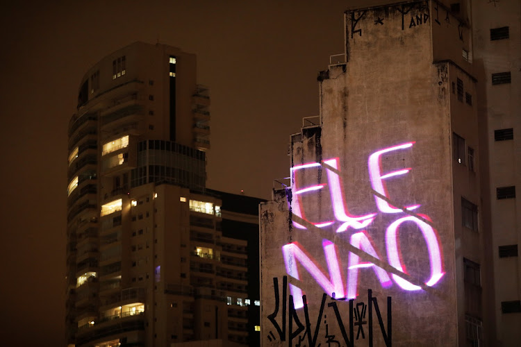 '#NotHim' is projected on the wall of a building, in reference to right-wing presidential candidate Jair Bolsonaro, in Sao Paulo.