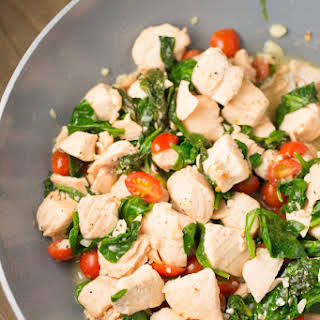 Salmon Scampi with Spinach and Tomatoes.