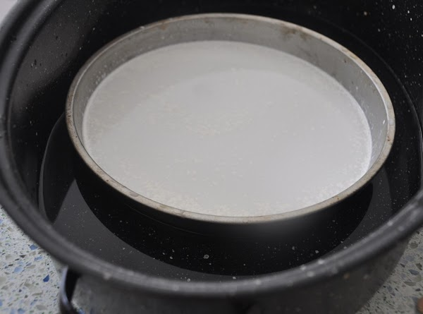 In a oven proof pot (I use my old fashion granite-ware roaster)place the cake...