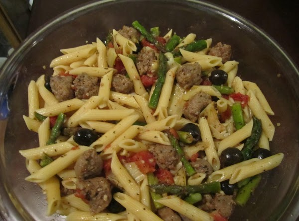 Place pasta in a serving bowl and pour the skillet mixture over pasta. Sprinkle...