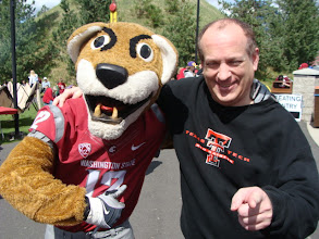 Photo: With Butch T. Cougar, the official mascot of the Washington State Cougars.