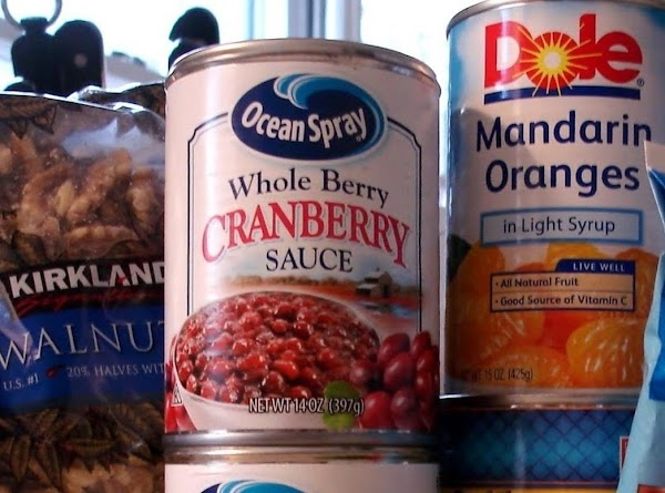 Place cranberry sauce in a large mixing bowl. Stir gently to break up the...