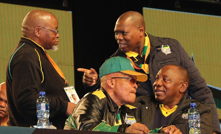 ANC deputy president Cyril Ramaphosa, secretary-general Gwede Mantashe and treasurer-general Zweli Mkhize have a conversation behind president Jacob Zuma at the top table during the opening of the party's National Policy Conference.    File picture: DAILY DISPATCH