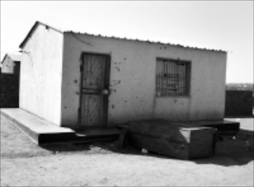 COMBAT ZONE: The pink house where police and ATM bombers exchanged fire resulting in the death of two bombers and the arrest of four others in Klipgat in North West. Pic. McKeed Kotlolo. 07/08/08. © Sowetan.