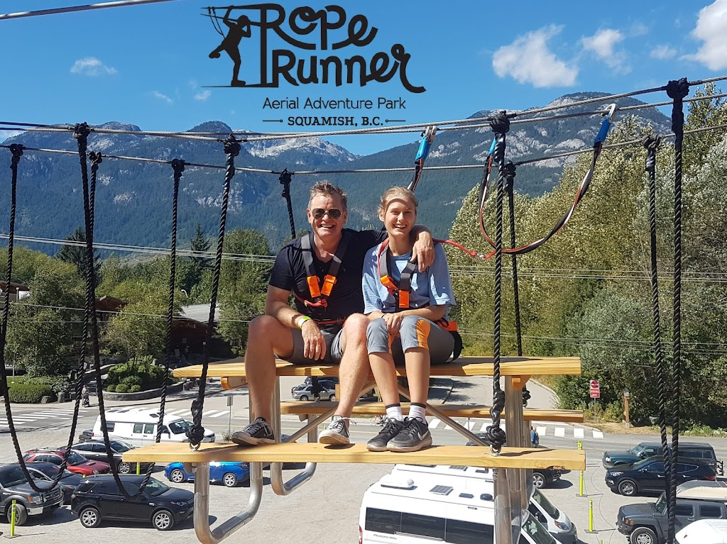 Visitors enjoying the high flying picnic table at Rope Runner