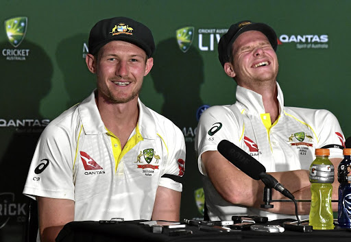 Australia's captain Steve Smith, right, reacts as teammate Cameron Bancroft. Picture: Reuters