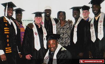 Photo: Teresa Turner with 2009 OU football graduates.