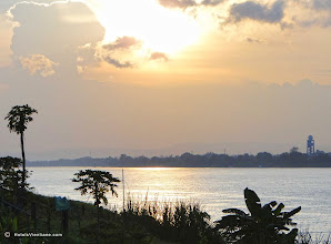Photo: Sunset over Mekong River with radar tower of Vientiane's Wattay International airport.