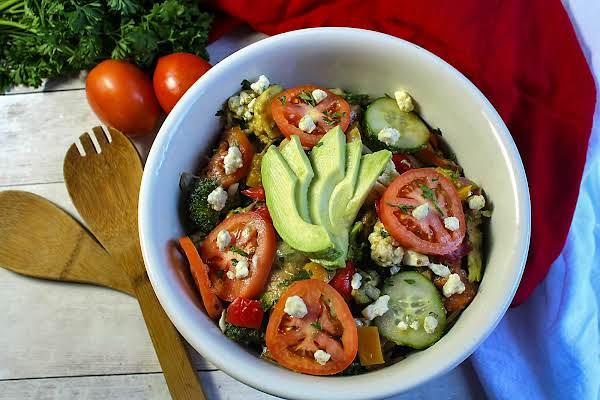 Avocado And Artichoke Hearts Holiday Salad In A Bowl.